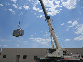 Crane lifting a furnace