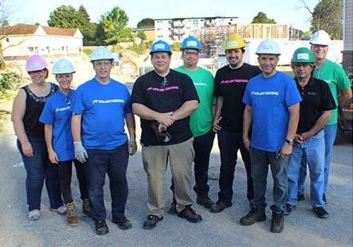 Team members at Cambridge Habitat for humanity build