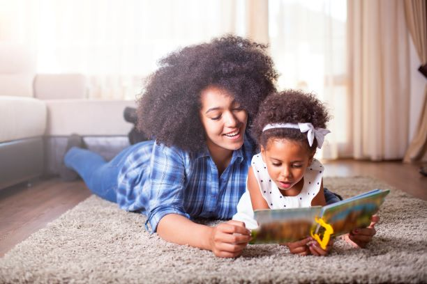 Mother and daughter reading together in their Sudbury home
