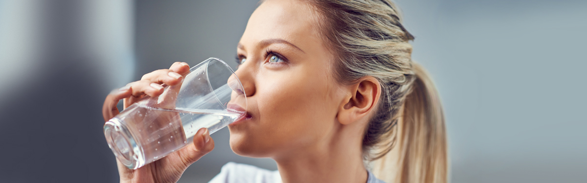 Woman drinking purified water