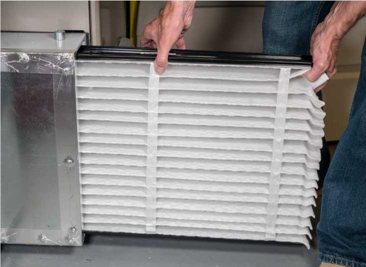 Man removing HVAC air filter