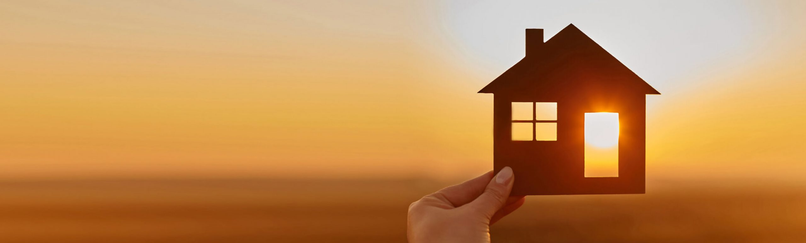 paper house in front of sunset