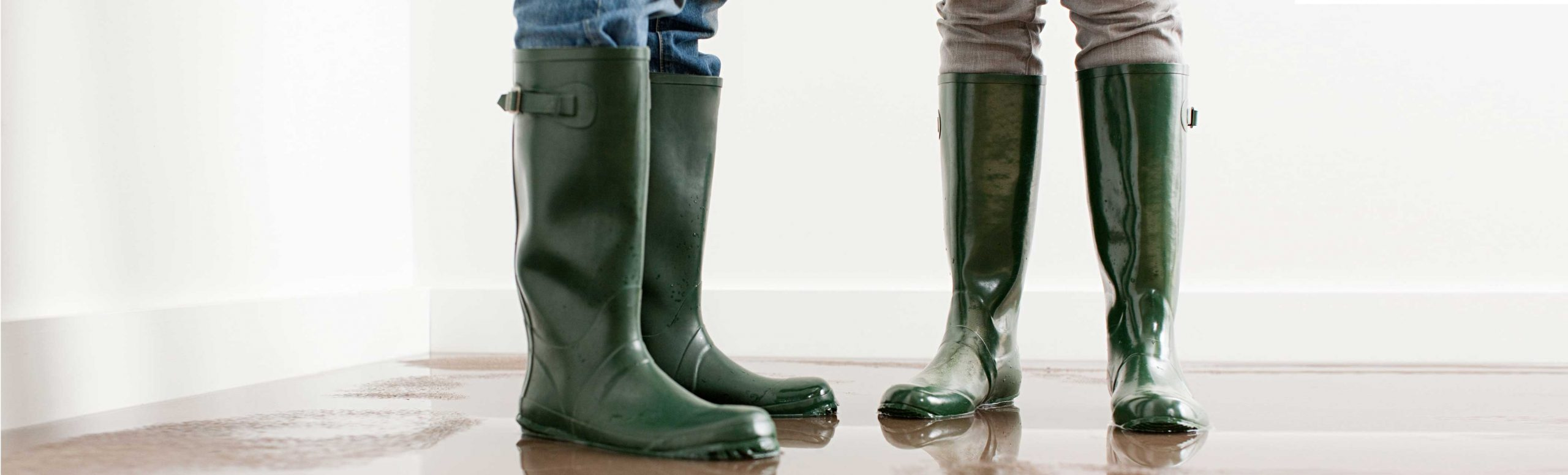 two people wearing rubber boots