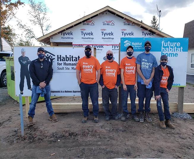 reliance team members at habitat for humanity job site