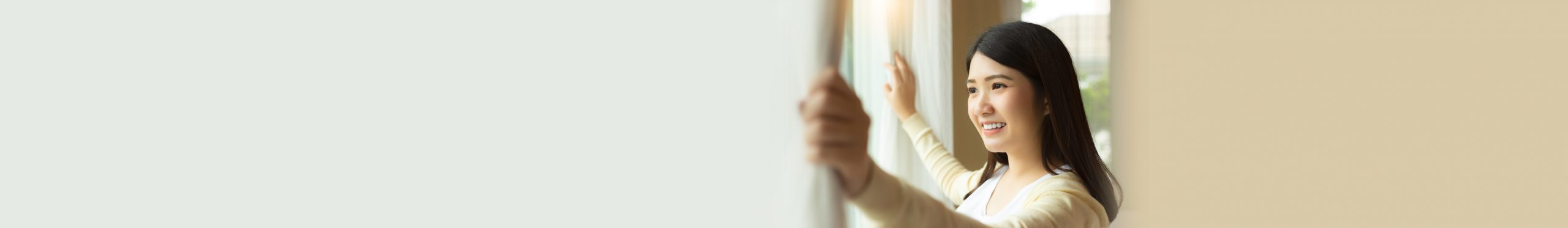 woman happily looking out window
